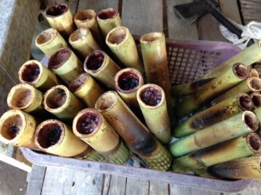 bamboo sticks stuffed with rice and pork