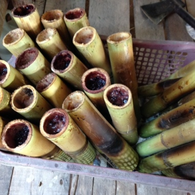 bamboo sticks stuffed with rice and pork