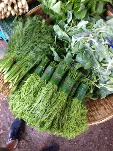 herbs bunched up with banana leaves