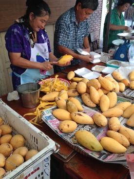 mangos being peeled