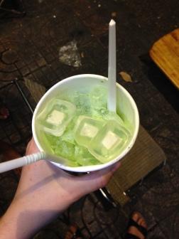 macha green tea with werid gummys on top